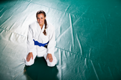 Young woman practicing Brazilian jiu-jitsu is a martial art, self defense system and combat sport.